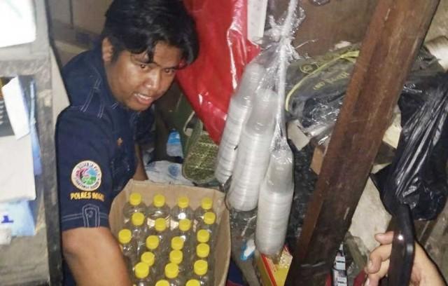 Polres Bogor Sita Ribuan Minuman Keras di Sebuah Gudang di Cibinong (foto: Berita Satu)